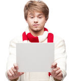 Young funny man holding sign Stock Image