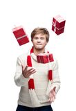 Young funny man juggle the christmas gifts Royalty Free Stock Images