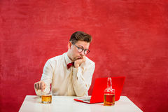 Young funny man with laptop at St. Valentine`s Day Royalty Free Stock Image