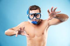 Young funny man playing with hands and wearing water mask Royalty Free Stock Photography