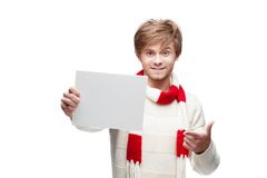Young funny man pointing at sign Stock Image