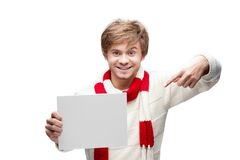 Young funny man pointing at sign Stock Photography