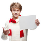 Young funny man pointing at sign Royalty Free Stock Image