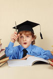 Young funny professor in academic hat with rarity pen Stock Photos