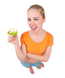 Young funny woman with apple Royalty Free Stock Photography