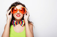Young funny woman with big orange sunglasses Royalty Free Stock Photos