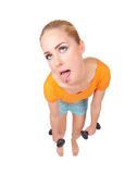 Young funny woman with dumbbells Stock Image