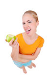 Young funny woman eat green apple Stock Images