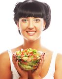 Young funny woman eating salad Stock Photo