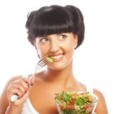 Young funny woman eating salad Stock Images
