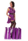 Young funny woman in funky style with purchases Royalty Free Stock Photo
