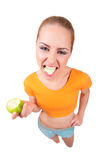 Young funny woman with green apple Stock Photo