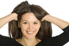 Young funny woman with hands in her hair Stock Photography
