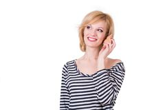 Young funny woman hearing sea shell and smiling Stock Image