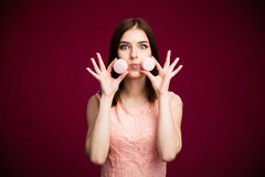Young funny woman holding cookies royalty free stock photography