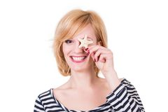 Young funny woman holding sea star and smiling Royalty Free Stock Photography
