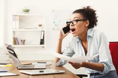 Business talk, furious woman talking on phone at office Royalty Free Stock Photo