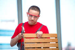 The young furniture carpenter in industrial concept Stock Photo
