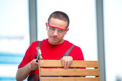 The young furniture carpenter in industrial concept Stock Image
