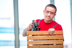 The young furniture carpenter in industrial concept Royalty Free Stock Images