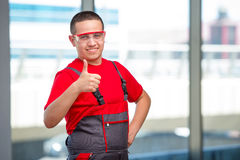The young furniture carpenter in industrial concept Stock Photography
