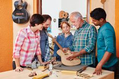 Young future artisans in apprenticeship. Young future artisans in craftsman`s apprenticeship royalty free stock images
