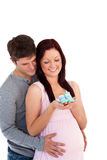 Young future parents looking at baby shoes Royalty Free Stock Images