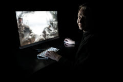 Young gamer in the dark. Young man playing computer games in dark room Stock Images