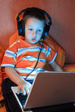 Young gamer with headphones Royalty Free Stock Photo