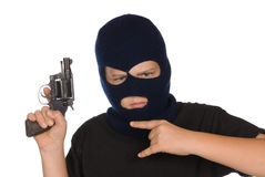 Young gang member. A young boy flashes his gang sign and weapon to show his committment to crime and bad ways Royalty Free Stock Photography