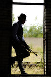 Young gangster. Silhouette of young gangster with rifle Royalty Free Stock Image