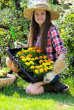 Young gardener and her new flowers Royalty Free Stock Photography