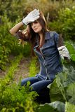 Young gardener woman working in her harden Royalty Free Stock Photos