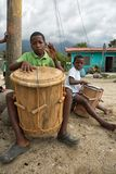 Young garifuna drummers in La Ceiba Honduras. March 8, 2015 Sambo Creek, Honduras: young garifuna boys playing traditional drums outdoors stock photo
