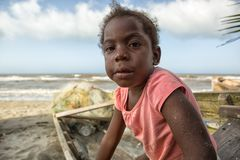 Young garifuna girl in La Ceiba Honduras. March 11, 2015 Sambo Creek, Honduras: a young garifuna girl part of the fishing community on the carribbean coast of stock images