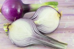 Young garlic on a magenta wooden board Stock Photos