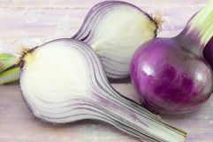 Young garlic on a magenta wooden board Stock Images