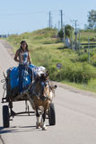 Young Gaucho woman and horse-drawn carriage on road, Uruguay stock photos