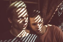 Young Gay Couple Standing Close To Each Other At Home Stock Image
