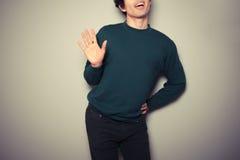 Young gay man is waving Stock Image