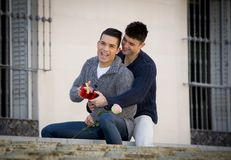 Young  gay men couple with rose and box present celebrating valentines day in love Royalty Free Stock Photo