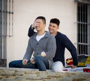 Young  gay men couple with rose and box present celebrating valentines day in love Stock Image