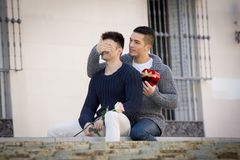 Young  gay men couple with rose and box present celebrating valentines day in love Royalty Free Stock Image