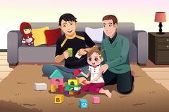 Young gay parents playing with their kid Royalty Free Stock Image