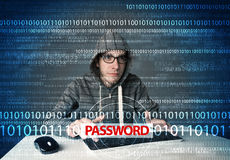 Young geek hacker stealing password Royalty Free Stock Photography