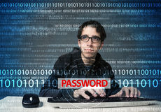 Young geek hacker stealing password. On futuristic background Royalty Free Stock Images