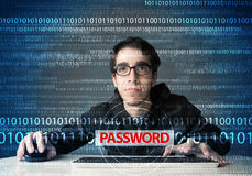 Young geek hacker stealing password Royalty Free Stock Photo