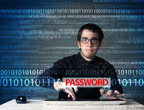 Young geek hacker stealing password Stock Photos