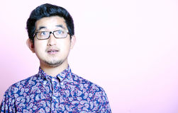 Young Geeky Asian Man in colorful shirt wearing glasses Royalty Free Stock Image