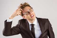 Young geeky businessman scratching his head Stock Images